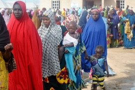 Women in Gombyo camp in Borno state line up to receive aid from local and international NGOs [Fragkiska Megaloudi/Al Jazeera]