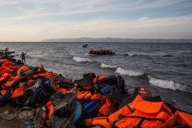 Thousands of refugees arrive each day in the Greek island of Lesbos. Life jackets from those who arrived previously cover the beach [Matthew Cassel/Al Jazeera]