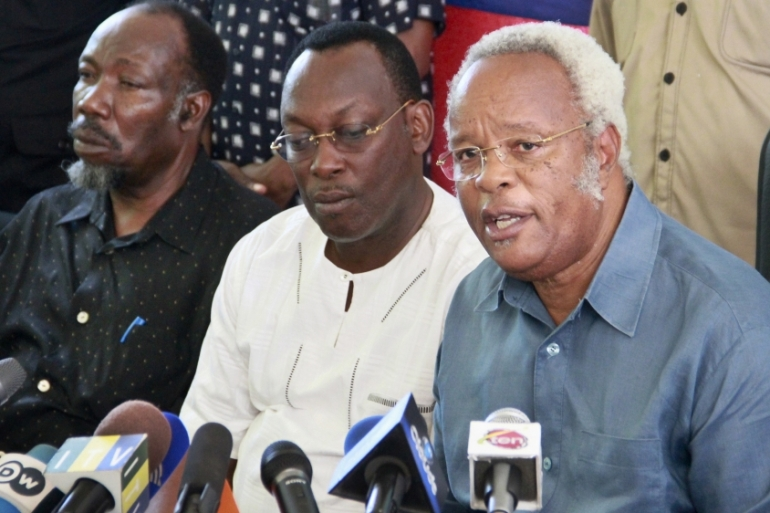 Tanzania's main opposition candidate Edward Lowassa, right, has rejected the result of the election [AP Photo]