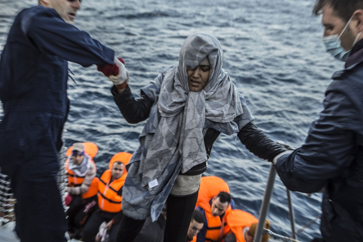 Women and children are given priority during the rescue. [Anna Pantelia/Al Jazeera]