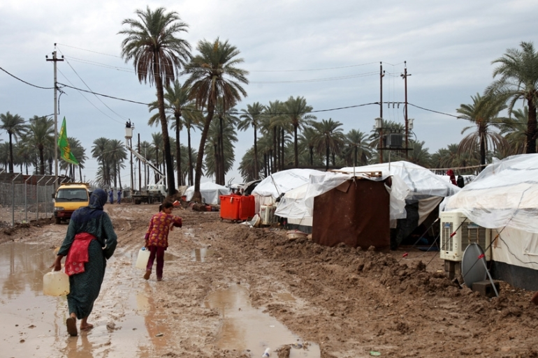 Miserable weather conditions persisted in refugee camps outside Baghdad after heavy rain [EPA]