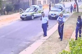 One of the stills from CCTV footage that showed the police officers shooting the robbery suspect at close range [YouTube/Sunday Times]