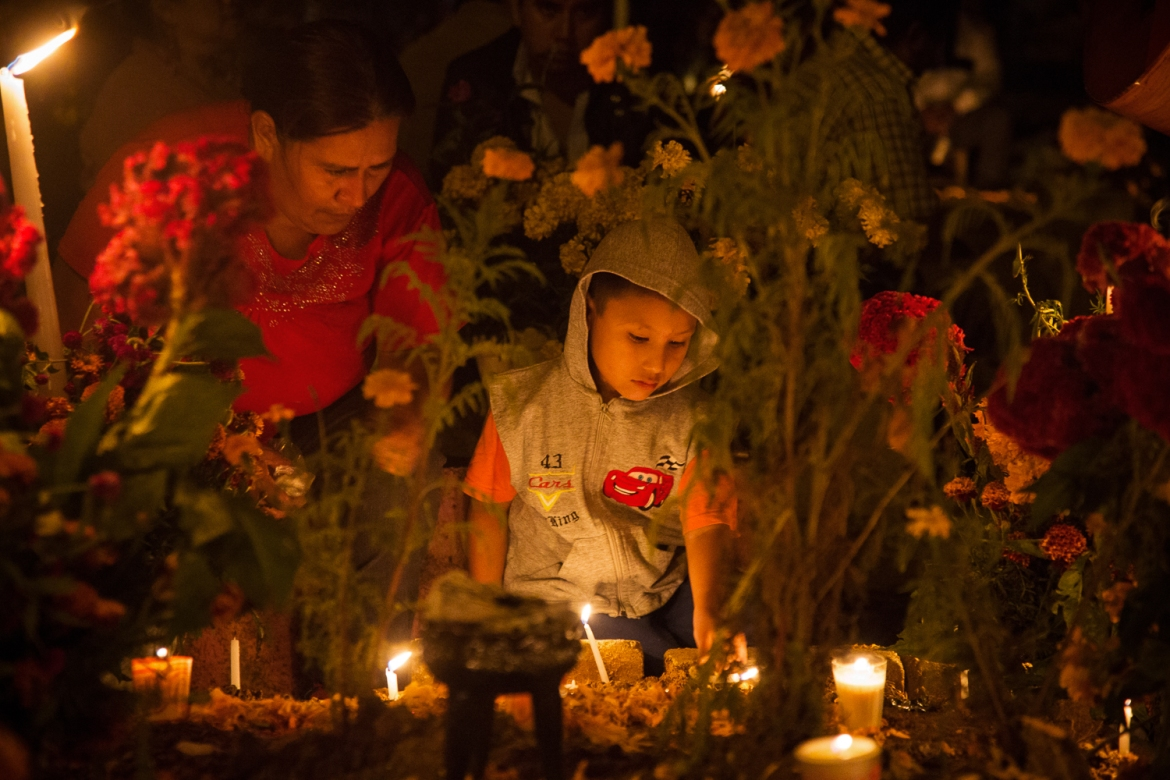 A cemetery on the outskirts of Oaxaca. Such places become the scenes of parties, as people gather to eat, drink and play music. [Gabbi Campos/Al Jazeera]