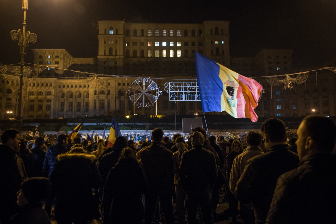 The Romanian flag with a hole in the middle represents the Romanian revolution of 1989, when communism ended. [Ioana Moldovan/Al Jazeera]