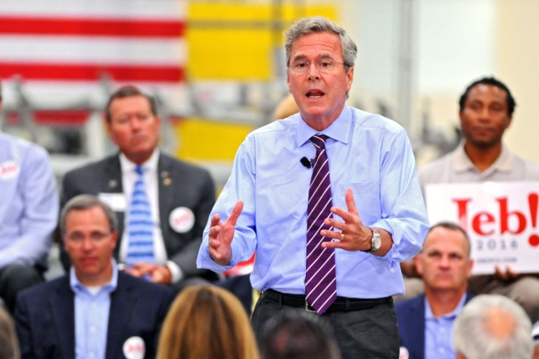 Battered by weeks of negative headlines, Bush is trying to reboot through his new slogan [Bob Mack/The Florida Times/AP]