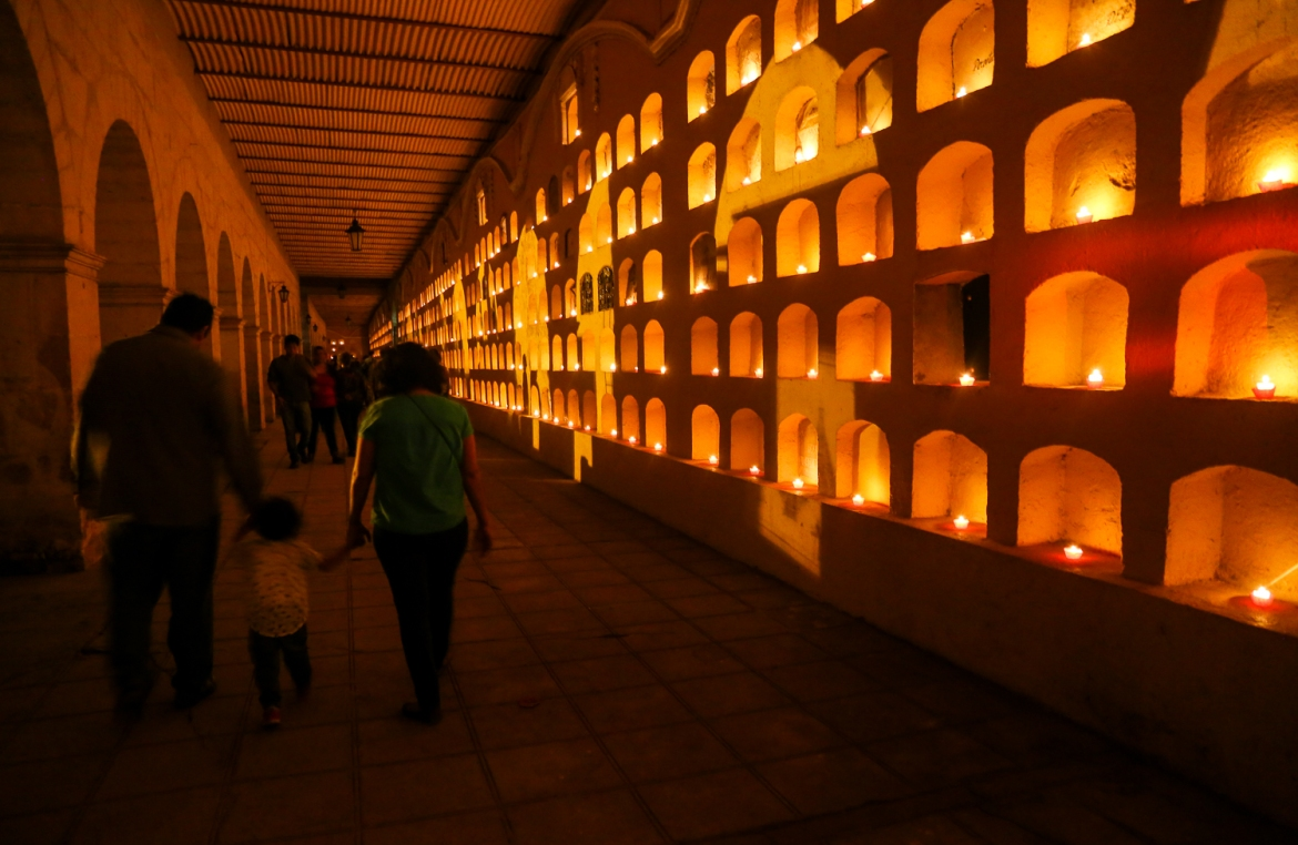 A wall of crypts in the General Cemetery in Oaxaca, the largest cemetery in the city. Families visit cemeteries on October 31 and November 1, decorating the graves and spending time with the souls of their deceased loved ones. [Gabbi Campos/Al Jazeera]