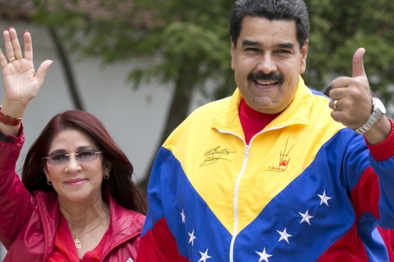Cilia Flores, who President Maduro calls the 'First Combatant', is one of the most powerful members of the government [AP]