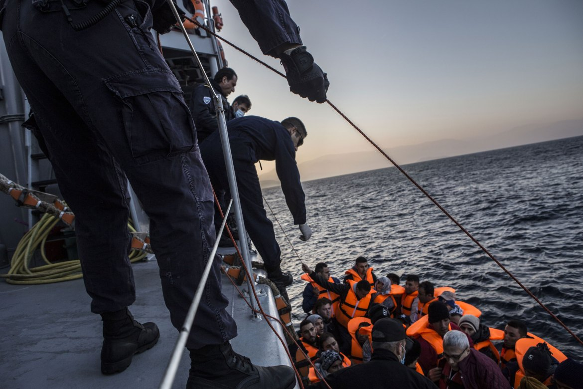 The coastguard crew drops a rope ladder to the refugees so they can climb aboard. [Anna Pantelia/Al Jazeera]
