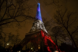 The Eiffel Tower in Paris was reopened and lit up in the colours of the French flag [AP]