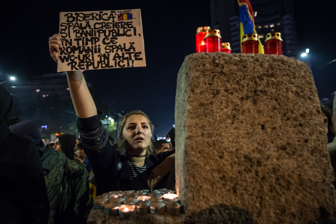 Protesters' slogans were also against the Romanian Orthodox Church. People were chanting: 'We want hospitals, no churches', related to the fact that there are a lot more churches in Romania than hospitals. [Ioana Moldovan/Al Jazeera]