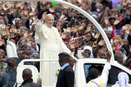 Pope Francis waves to the faithful as he arrives for a Papal mass in Kenya's capital Nairobi [Thomas Mukoya/Reuters]