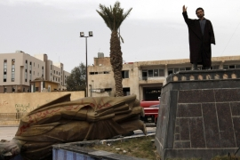 A man in Raqqa stands where a statue of Bashar al-Assad's father Hafez used to be [Hamid Khatib/Reuters]