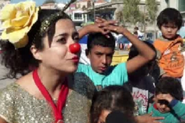 Clowns give refugees a chance to smile in Greece