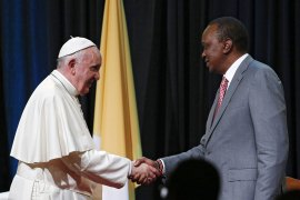 Pope Francis greets Kenyan President Uhuru Kenyatta during a meeting with government officials and members of the diplomatic corps at the State House in Nairobi, Kenya [Paul Haring/EPA]