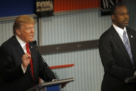 Leading Republican candidates Donald Trump, left, and Ben Carson have been criticised for sweeping comments about Muslims and refugees [File: Morry Gash/AP]