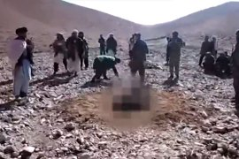In the video, the woman is put in a hole with only her head visible and several men throwing stones at her head [Al Jazeera]