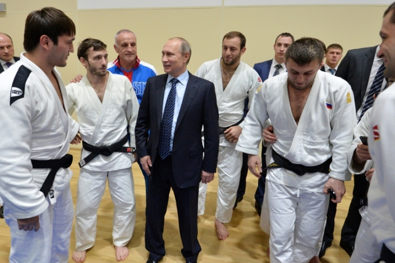 Putin speaks to athletes before his late-night meeting with the heads of Russia's sports federations in Sochi, Russia [AP]