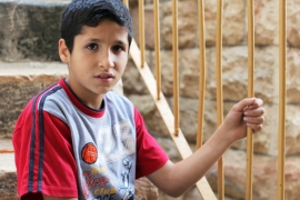 'The only thing I want to do is play, play without care - the way [the settler children] do,' Saed Seider said [Abed al-Qaisi/Al Jazeera]