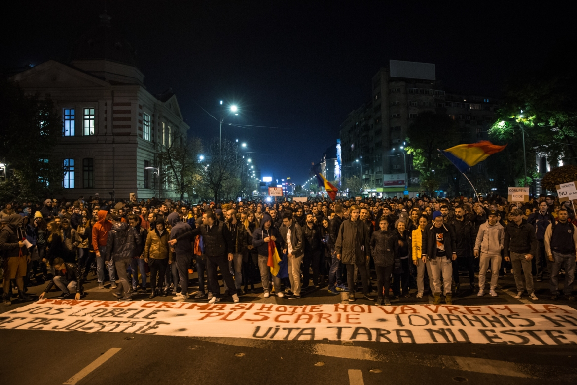 Protesters march to the University Square chanting 'Romania is not for sale.' [Ioana Moldovan/Al Jazeera]