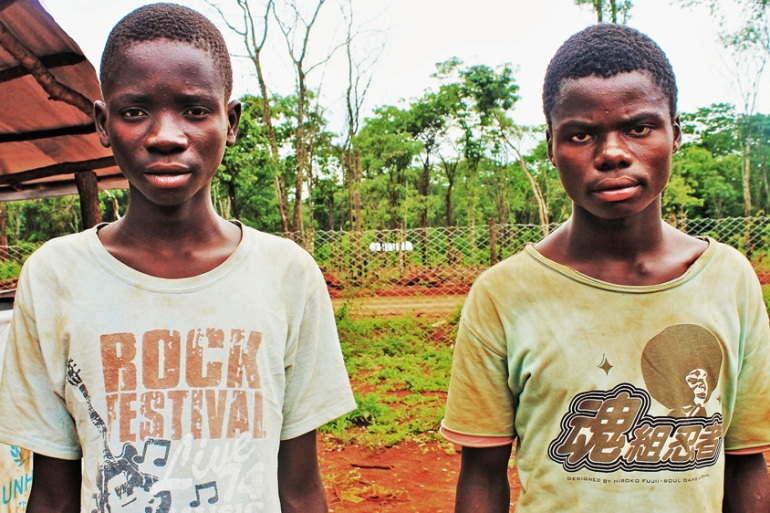 Cousins on the run Eliose Kabula, 16, left, and Fulpence Ndikumwenayo, 18, left Burundi to avoid joining the Imbonerakure [Tendai Marima/Al Jazeera]