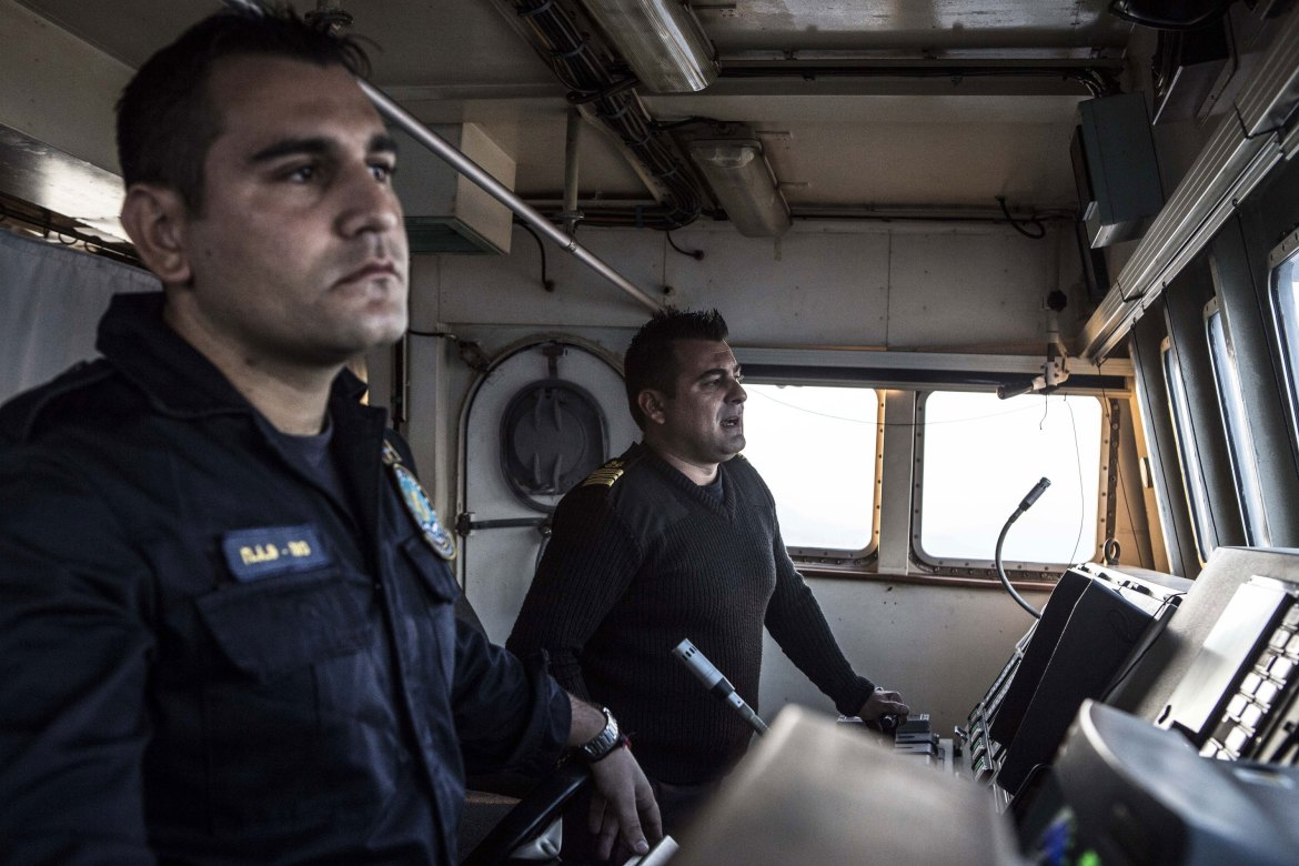 Captain Frangoulis keeps a close eye on the radar screen and scours the sea for signs of a vessel in need of help. [Anna Pantelia/Al Jazeera]