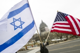 Pro-Israel demonstrators wave flags in front of the Capitol in Washington in March as Benjamin Netanyahu addressed Congress [AP]