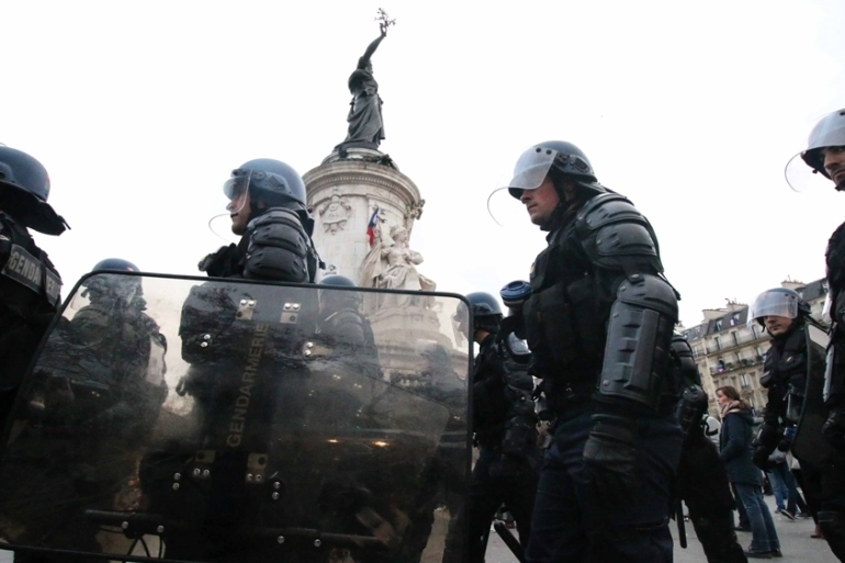 Heavy police presence in the streets of Paris after the November 13 attacks [Yann Schreiber/Al Jazeera]