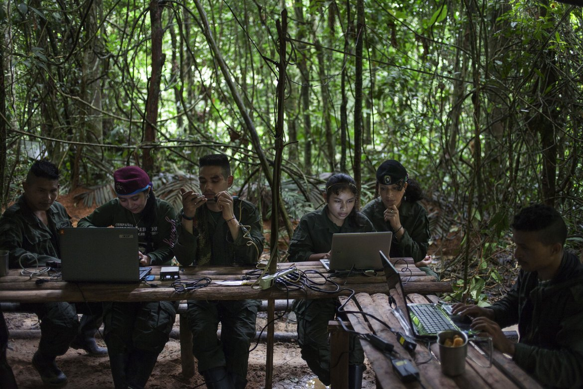 No mobile phones or other transmitting devices are allowed in the camps to avoid detection. But rebels learn how to build modems to communicate with other divisions and the FARC's secretariat. Two or three rebels then walk a few hours away from the camp to communicate without giving up the camp's location. [Fabio Cuttica/Al Jazeera]