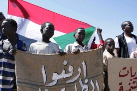 Sudanese children hold a banner reading 'Lift the injustice' during a protest against US sanctions in Khartoum last month [EPA]