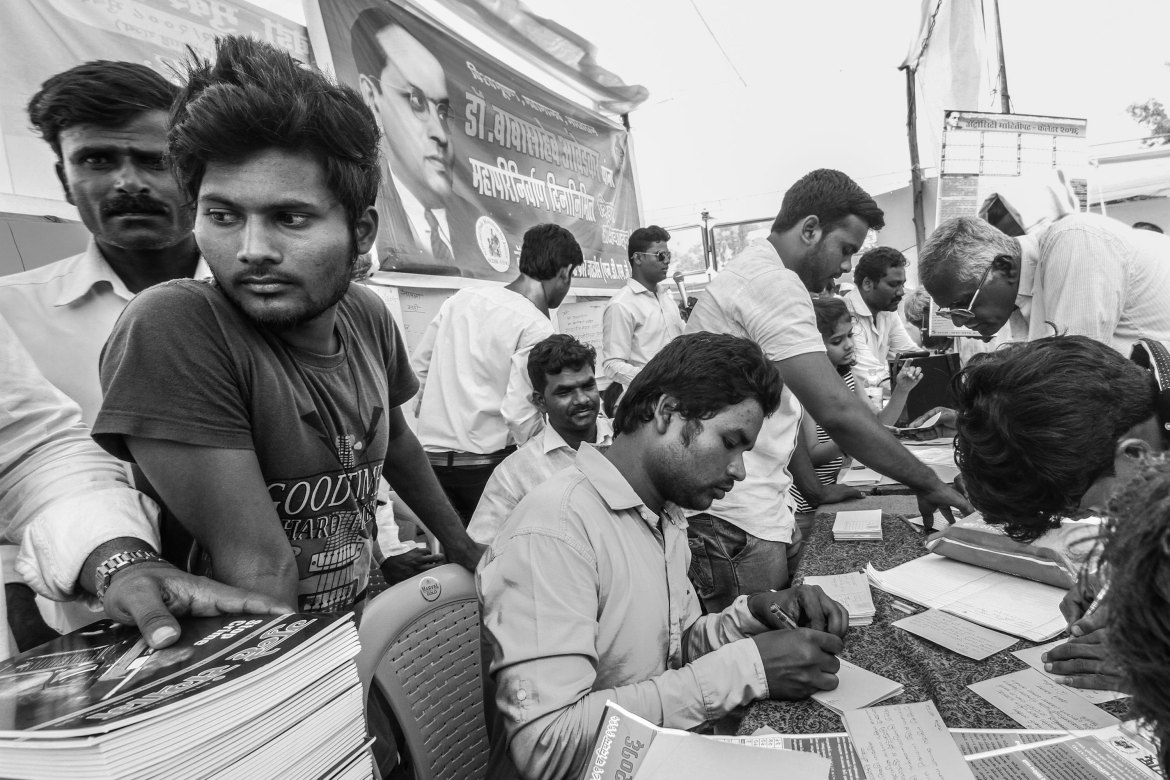 On one of the stalls this year, the National Dalit Movement for Justice invited people to write postcards to the Chief Minister of Maharashtra state, of which Mumbai is the capital, to protest against violence against Dalit communities. [Javed Iqbal/Al Jazeera]
