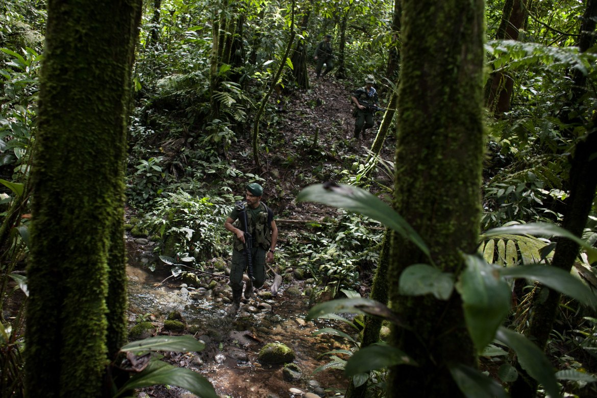 Rebels guard the camps against potential soldier activity. FARC has promised to demobilise 60 days after the eventual signing of a peace agreement. [Fabio Cuttica/Al Jazeera]