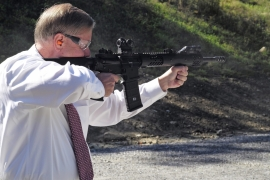 US senator and Republican presidential candidate Lindsey Graham fires an AR-15 during a factory visit in October [EPA]