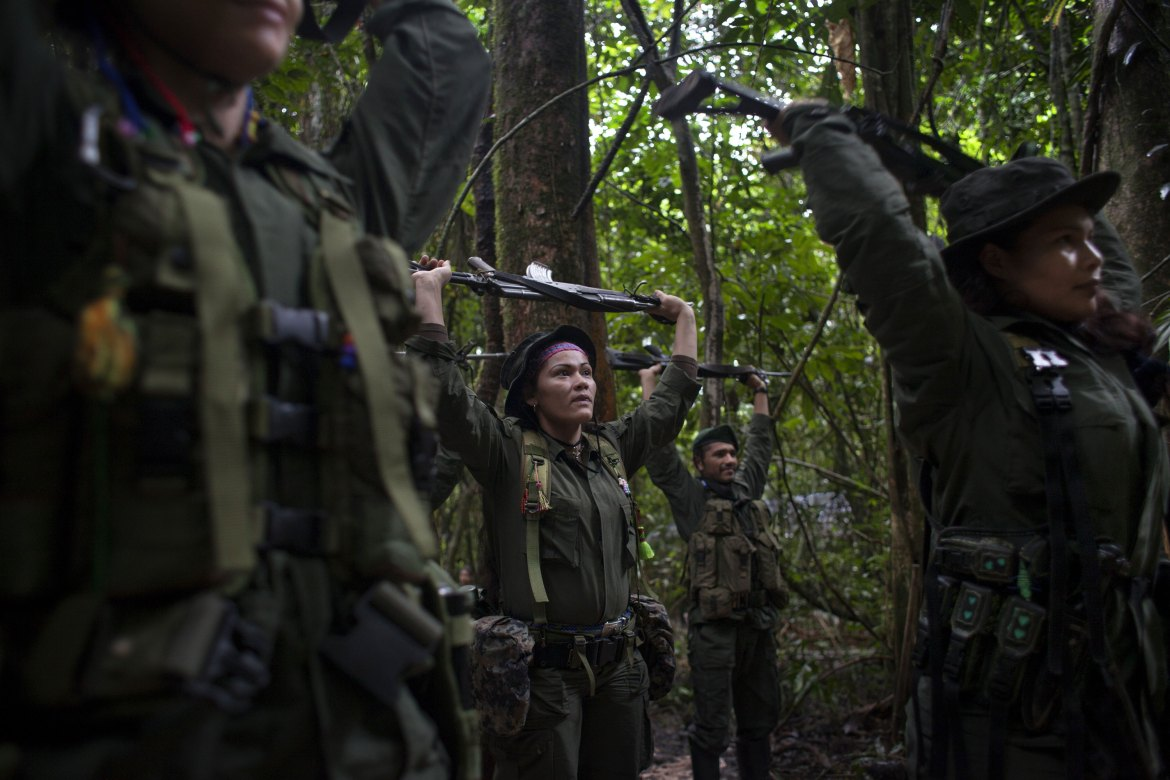 Rebels from the Eastern Bloc of the FARC exercise in the early mornings with their rifles. These could be the last days in the jungle for the rebel organisation that has been at war with the Colombian government for 51 years. [Fabio Cuttica/Al Jazeera]
