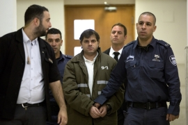 The court has accepted a petition to hear a claim of insanity by accused killer Yosef Haim Ben-David, pictured at centre [AP]