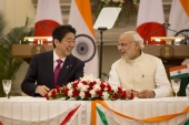 Narendra Modi talks with Shinzo Abe during the signing of agreement ceremony in New Delhi, India in December 2015 [AP]