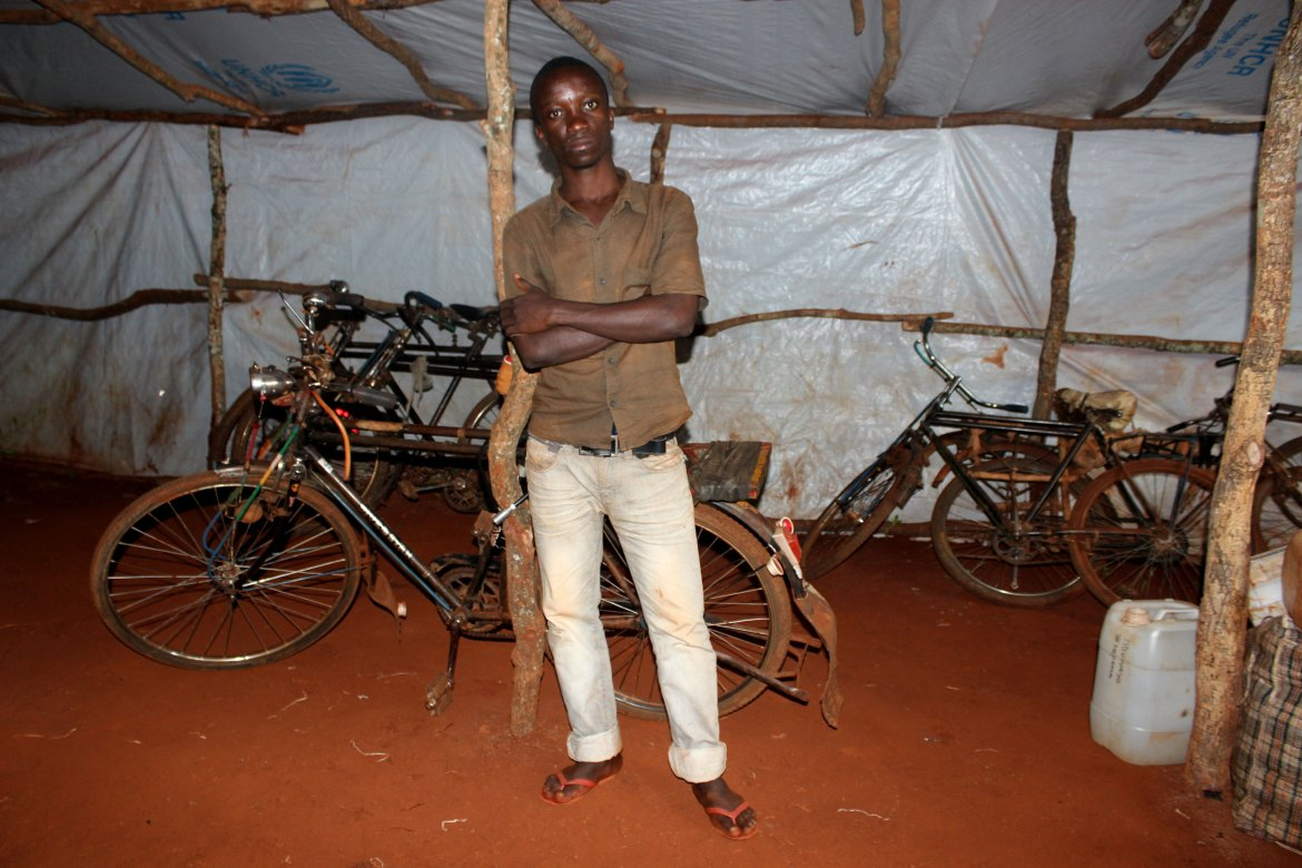 Aaron Hakidzimana, 23, awaits transfer from Nyarugusu to Nduta camp. He was an English and French teacher in a private primary school. A feud between his father and his pro-government uncle forced his father to flee to Uganda while Hakidzimana escaped to Tanzania by bicycle. [Tendai Marima/Al Jazeera]