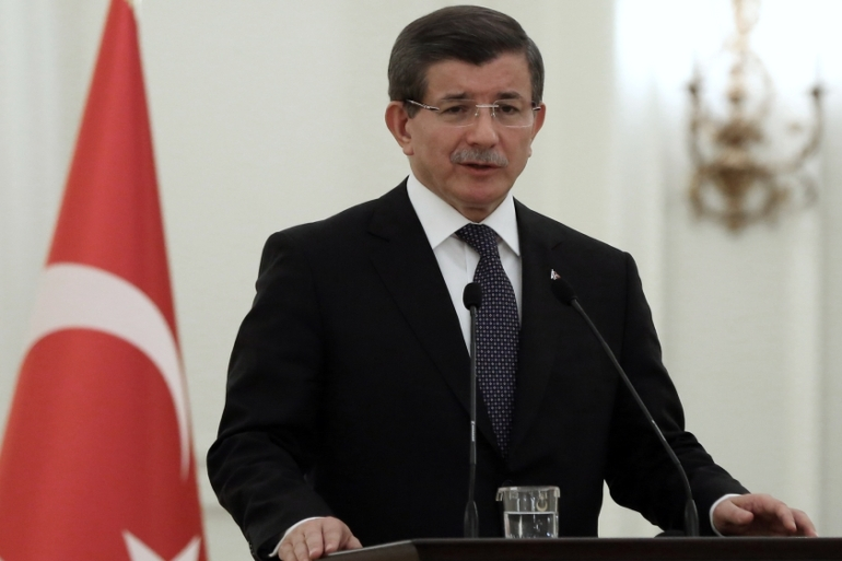 Turkish PM Davutoglu said the military fired some 500 times on ISIL positions in Iraq and Syria [AP]