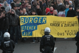 Right-wing demonstrators carry a banner reading: Citizens get up, Protect our children and future [Juergen Schwarz/AP]