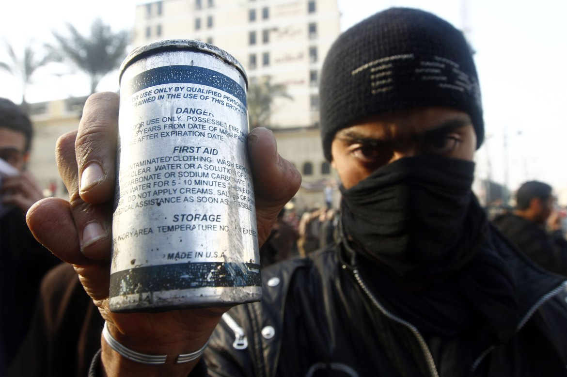 A protester displays a tear gas canister during clashes in Cairo. [Yannis Behrakis/Reuters]