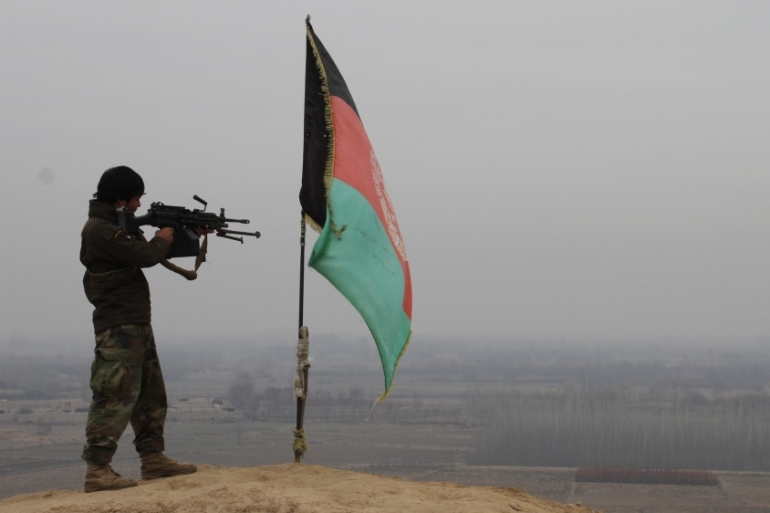 A member of the Afghan security forces takes up a position during an operation against Taliban fighters in Kunduz [EPA]