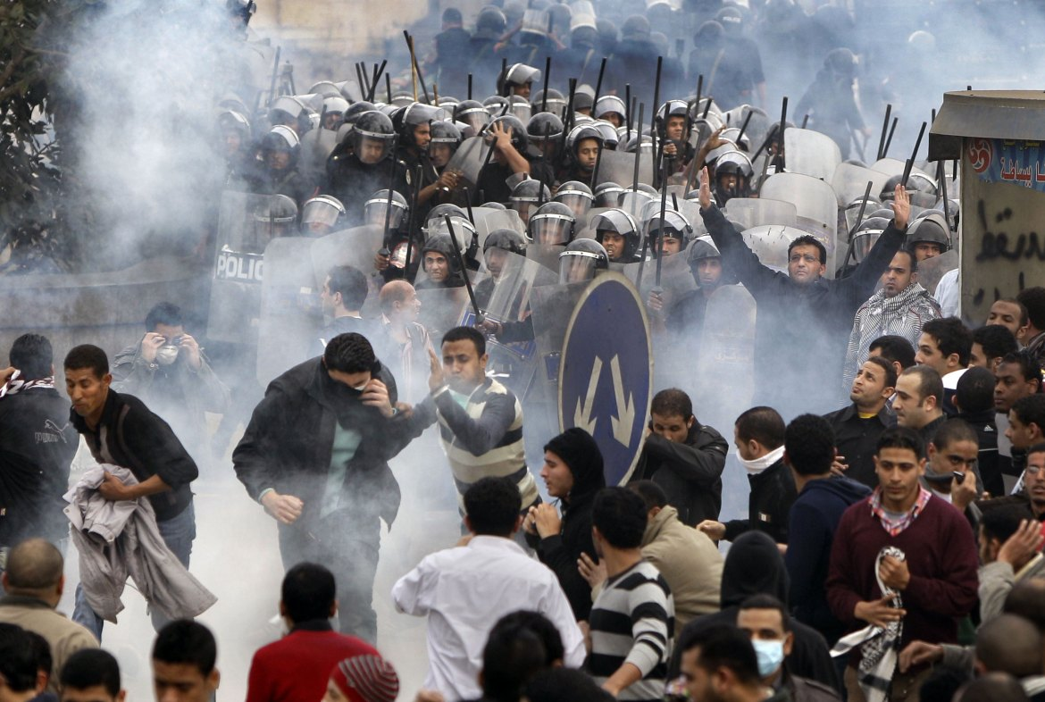 Protesters clash with riot police in Cairo on [Ben Curtis/AP]