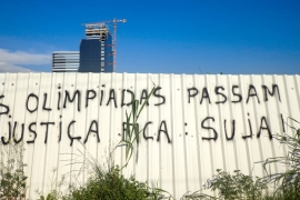 'The Olympics pass, justice remains dirty', reads a message written in a Rio favela [Maya Thomas-Davis/Al Jazeera]