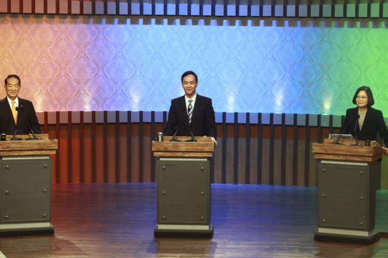 Taiwan's 2016 presidential election candidates at the start of  their first televised policy debate in Taipei. Taiwan will hold its general elections on January 16. [Chuck Chen/AP]