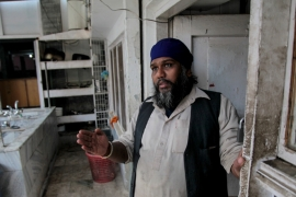 Mukesh, the head cook at the Karte Parwan Gurudwara, the central place of worship for Kabul's dwindling Sikh community [Sune Engel Rasmussen/Al Jazeera]