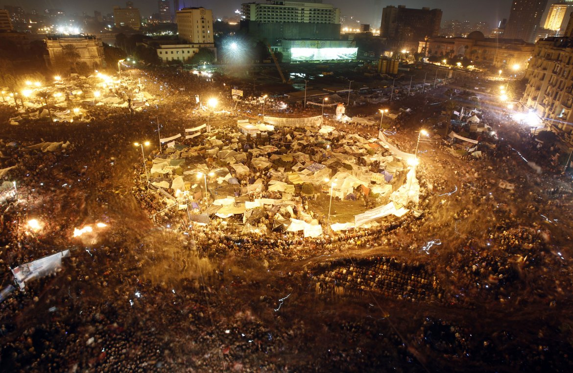 Protesters celebrate in Tahrir Square after the announcement of Mubarak's resignation. [Amr Abdallah Dalsh/Reuters]