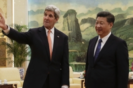 US Secretary of State John Kerry with Chinese President Xi Jinping in Beijing [AP]