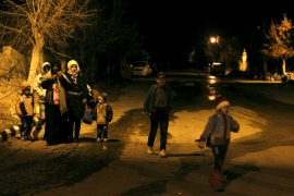Residents of besieged Madaya wait to leave the town after receiving government permission [AP]