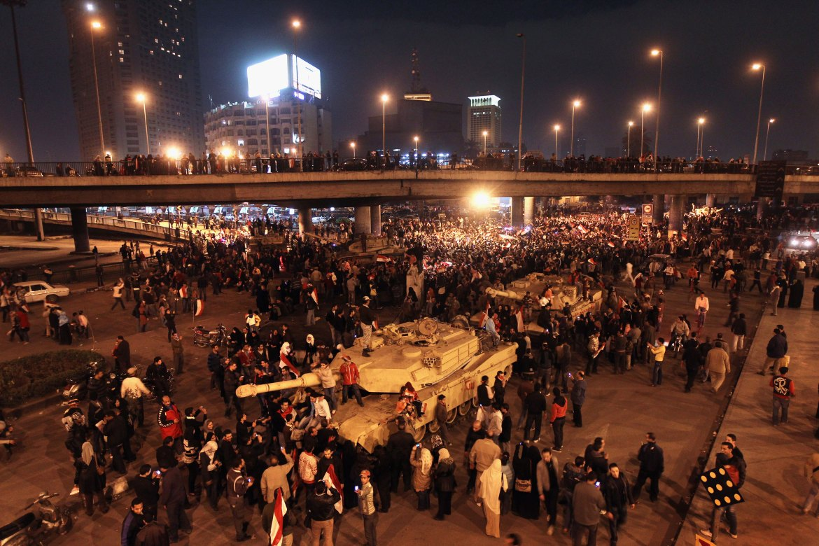 Egyptians climb on to tanks after hearing the news of the resignation of Hosni Mubarak on February 11. [John Moore/Getty Images]