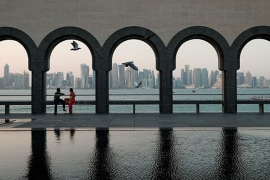 Visitors relax on the grounds of the Museum of Islamic Art in Doha, Qatar [Getty]