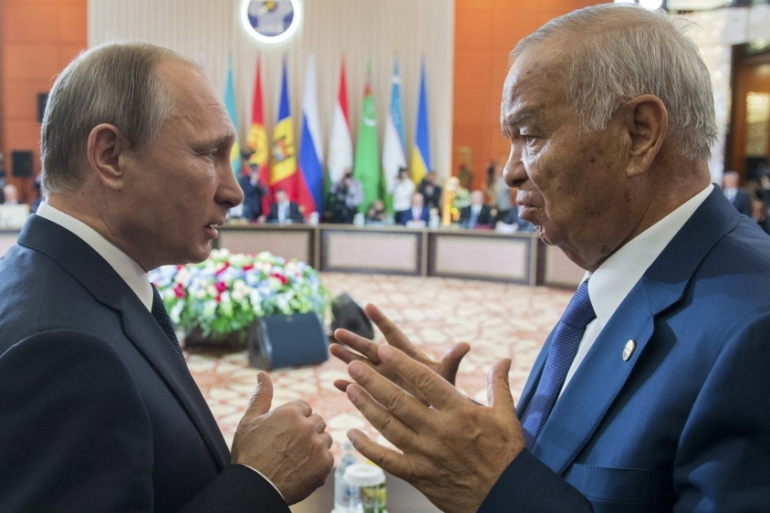 President Islam Karimov is accused of renewing ties with Russia to suppress opposition [Ria Novosti/Reuters]